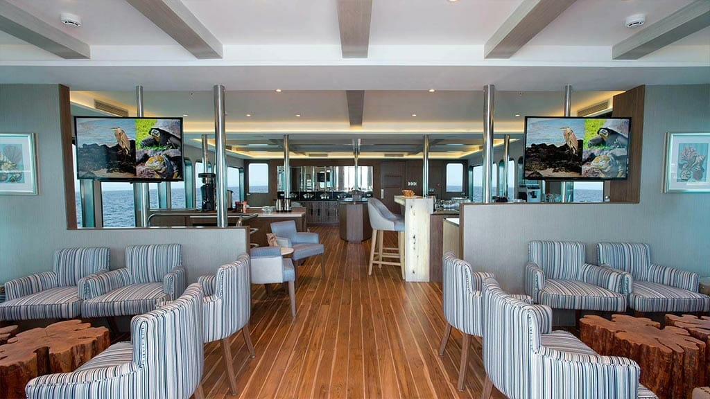 Origin yacht Galapagos cruise - indoor social lounge with tv