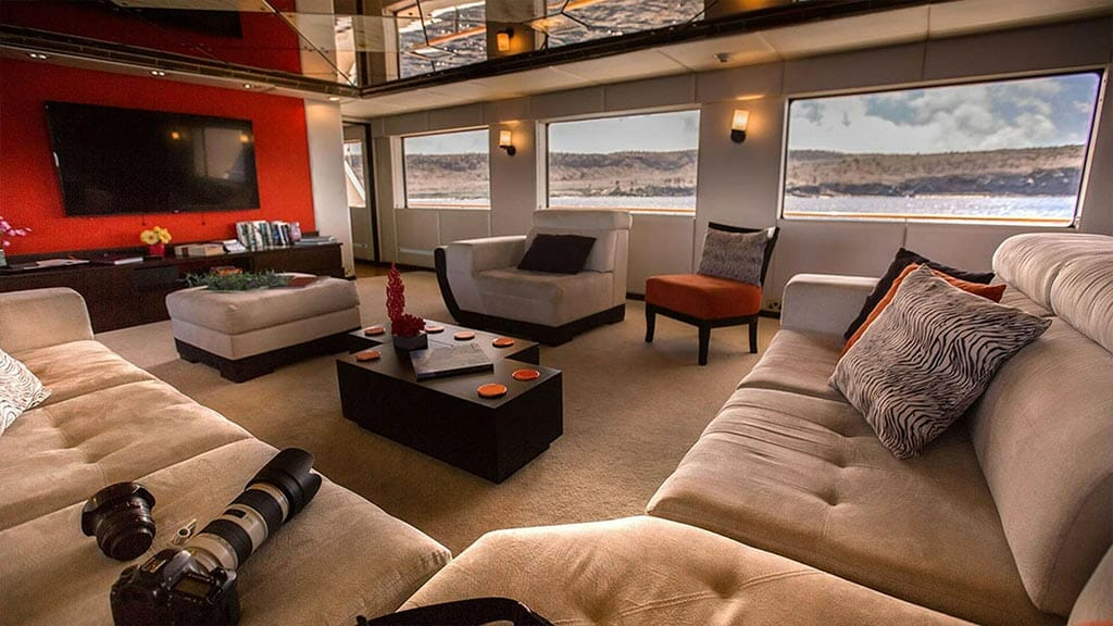 passion galapagos yacht - indoor social guest lounge with sofas and tv