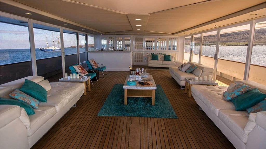 passion galapagos yacht - indoor social guest lounge with sofas
