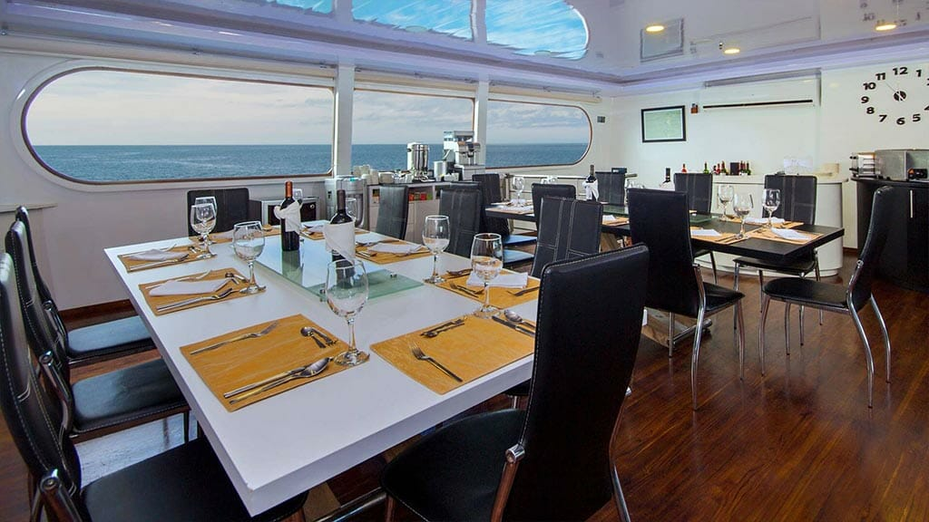 Petrel galapagos yacht - dining tables laid ready for dinner