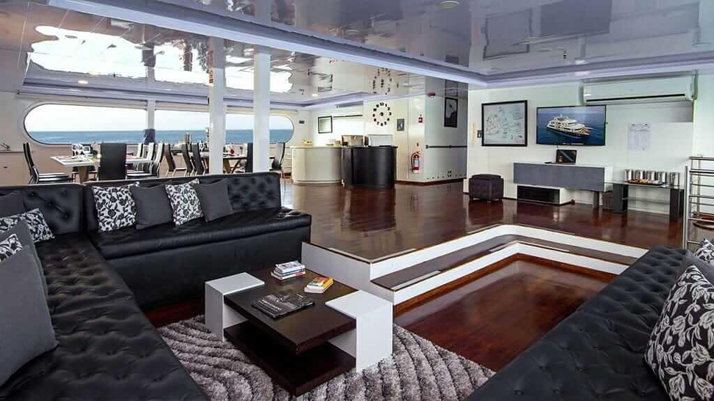 Petrel yacht Galapagos cruise - spacious social lounge area