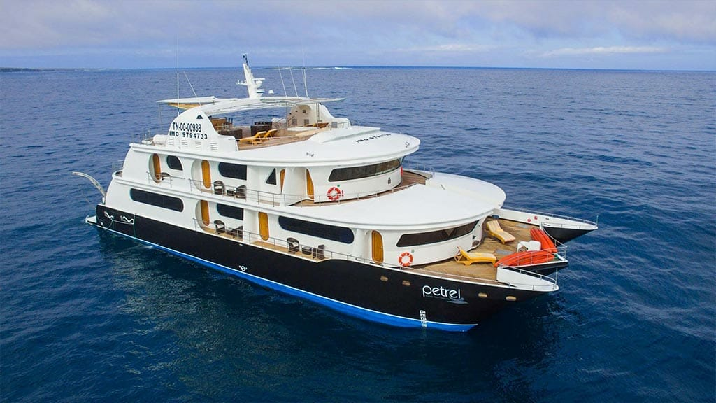 side on view of the Petrel yacht in blue ocean at the galapagos islands