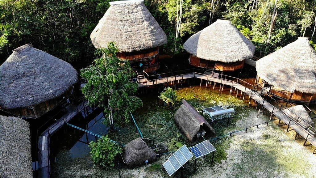 aerial view of piranha lodge and cabins at cuyabeno reserve surrounded by jungle