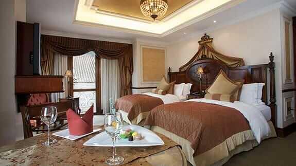 elegant twin bedroom at plaza grande hotel quito ecuador