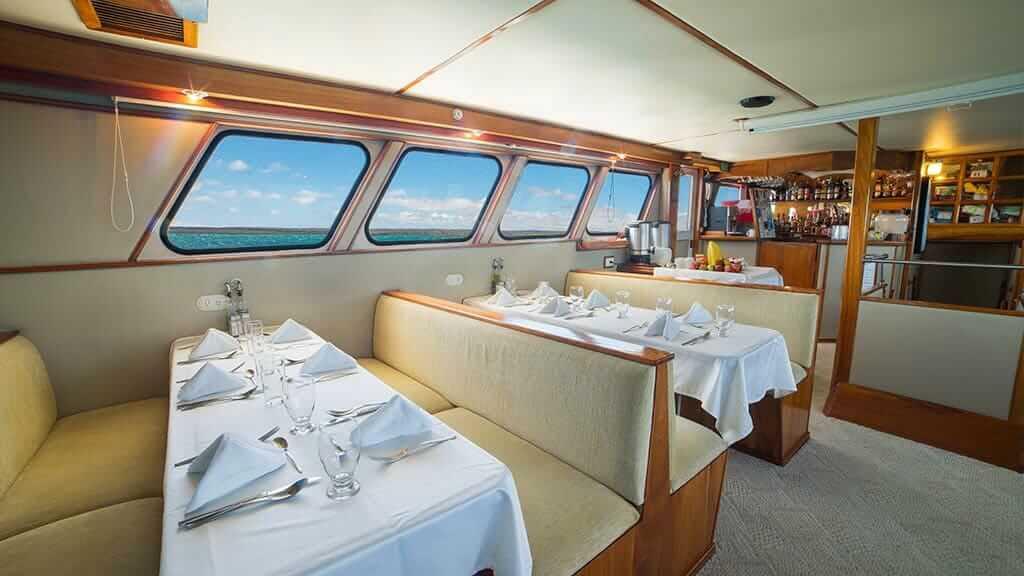reina silvia yacht galapagos cruise - indoor dining area
