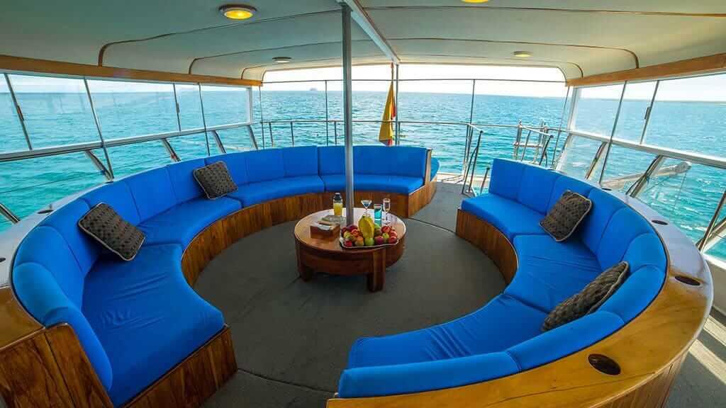 reina silvia yacht galapagos cruise - circular sofa spcial lounge with ocean views