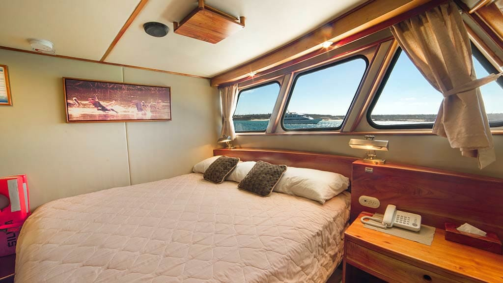 double bed cabin aboard the reina silvia galapagos yacht