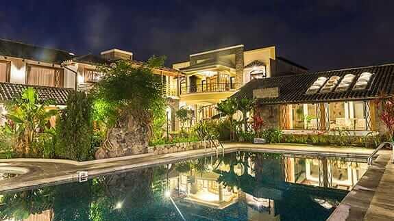 illuminated exterior and pool at rincon de puembo hotel quito ecuador