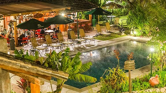 outdoor swimming pool and loungers at rincon de puembo hotel quito ecuador