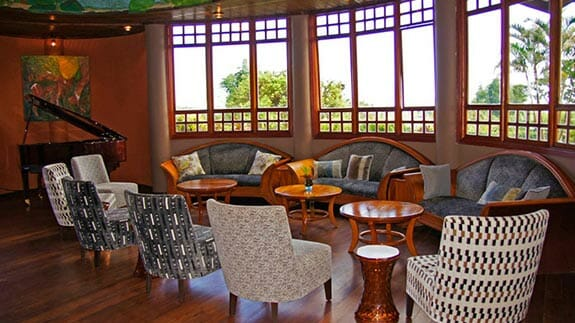 Royal Palm Hotel, Santa Cruz Highlands, Galapagos – social lounge area with piano