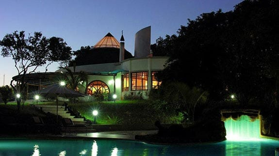 swimming pool at night at Royal Palm Hotel, Santa Cruz Highlands, Galapagos