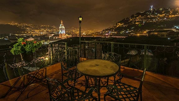 views of colonial quito at night from hotel san francisco terrace