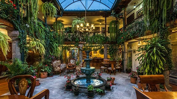indoor patio with fountain and plants at hotel san francisco quito ecuador