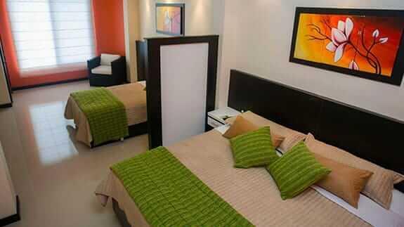 triple bedroom at San Vicente hotel puerto villamil, isabela, galapagos islands