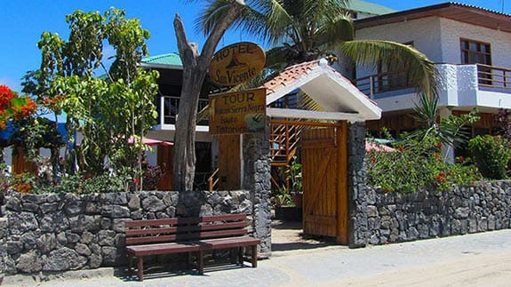 entrance and stone wall of exterior San Vicente hotel puerto villamil, isabela, galapagos islands