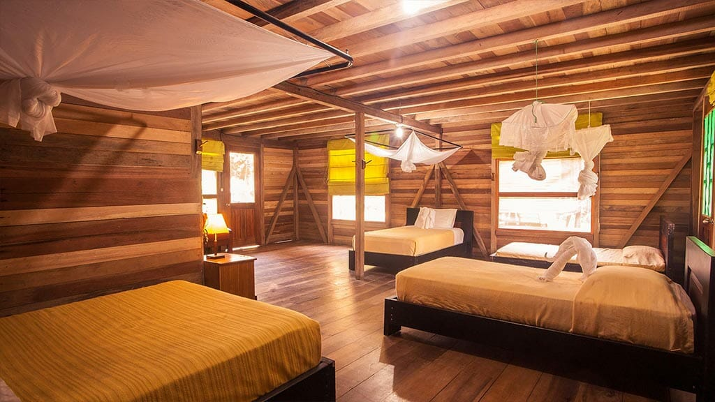 cuadruple bed room cabin with mosquito nets at Sani lodge ecuador amazon rainforest