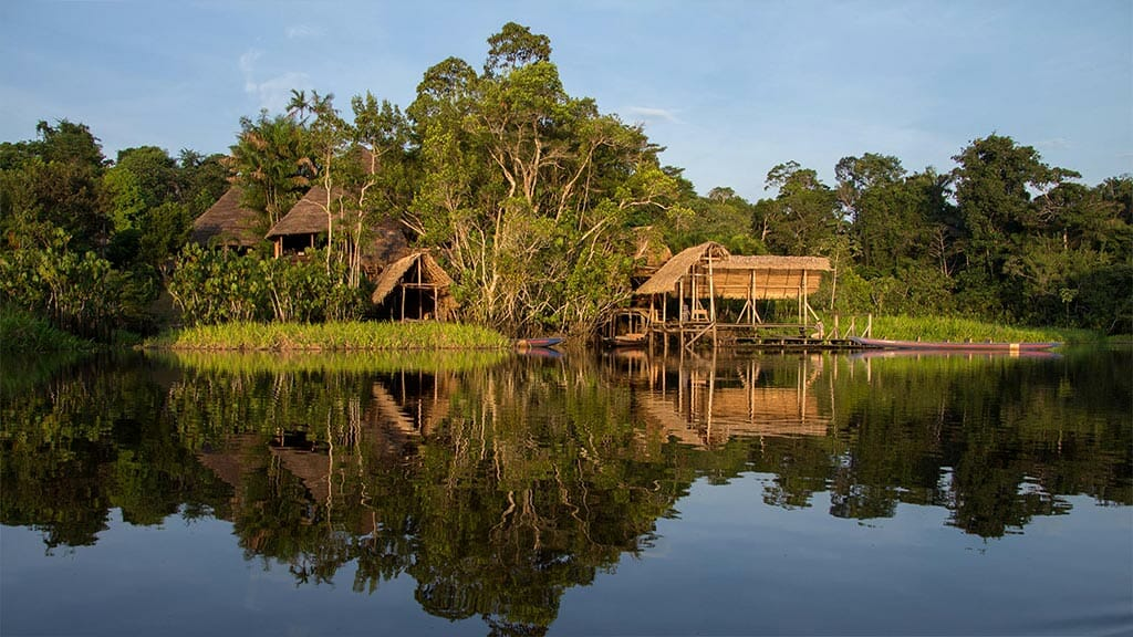 Sani lodge ecuador surrounded by rainforest trees and lake