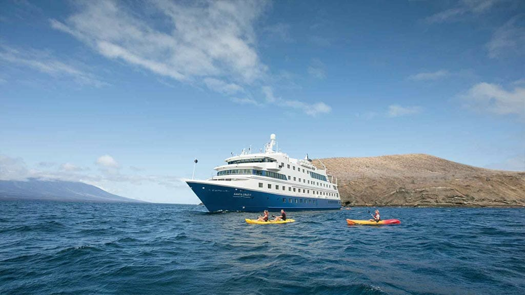 santa cruz ii cruise ship at Galapagos with tourists kayaking