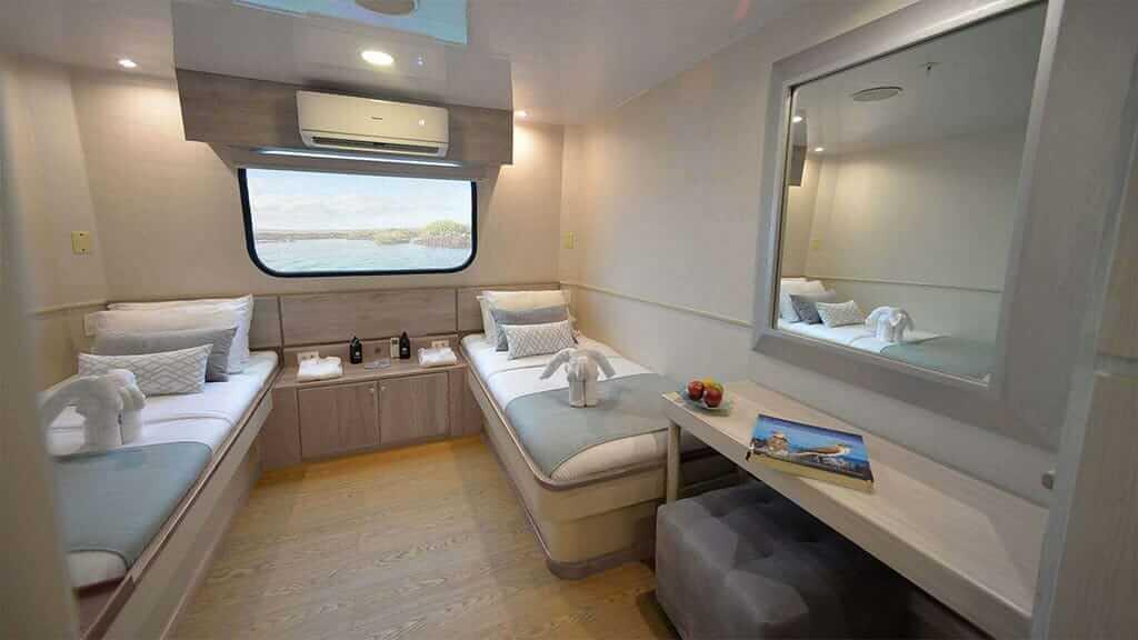 twin guest cabin aboard the Seaman Journey catamaran