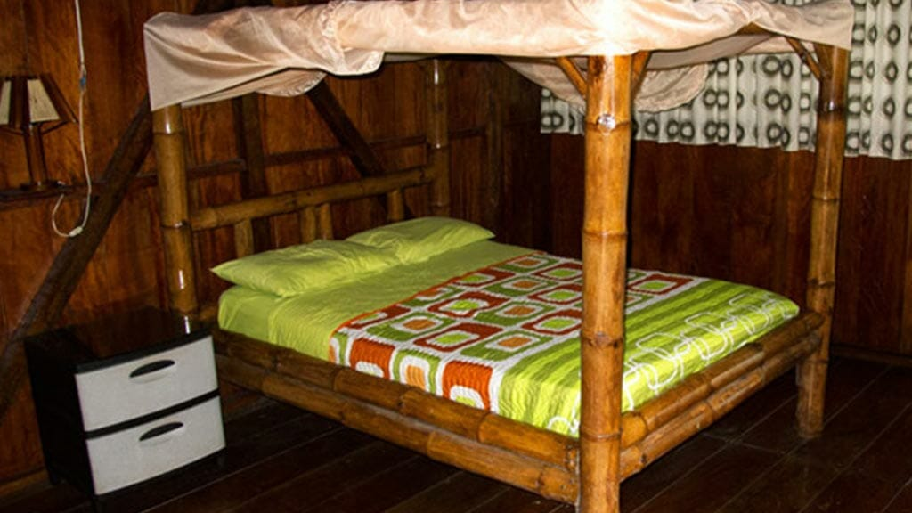 Siona lodge ecuador - double bedroom with mosquito net