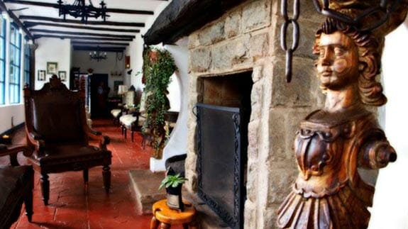 open fireplace and statue at su merced hotel quito airport