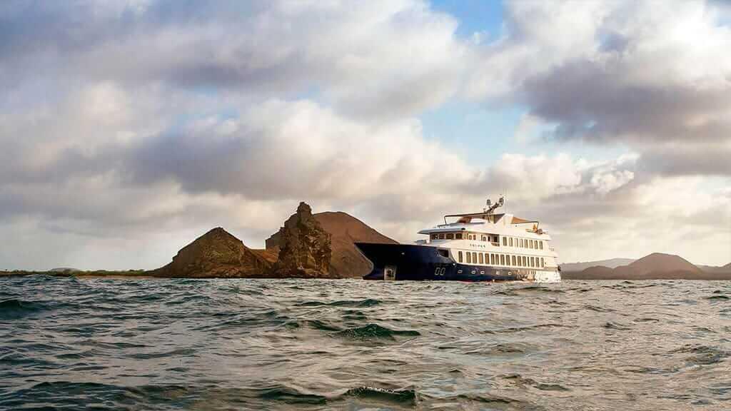 Theory galapagos yacht anchored at pinnacle rock bartolome