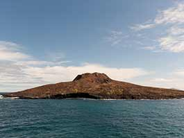 chinese hat galapagos island with blue ocean and skies