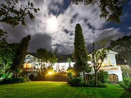 hacienda cusin and garden illuminated at night