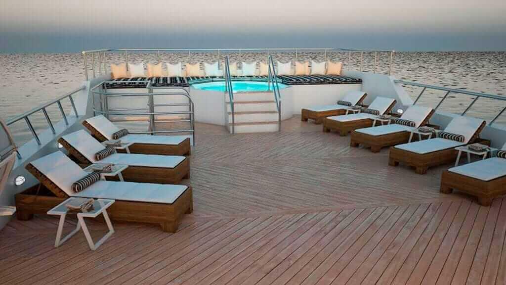 Tiburon Explorer galapagos dive yacht - sun deck with loungers and jacuzzi illuminated at night