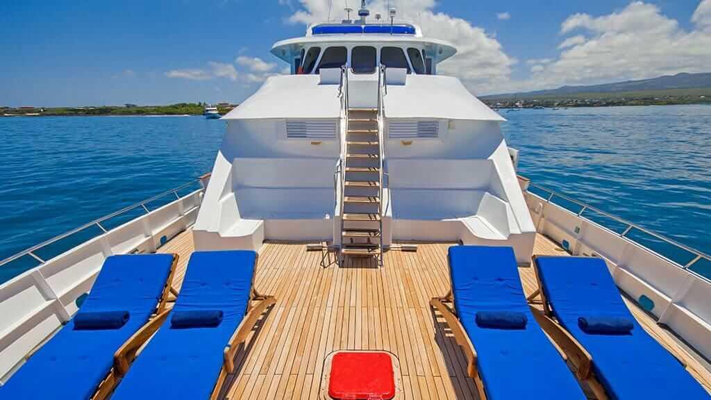 blue sun loungers on TipTop 4 galapagos yacht sun deck with ocean views