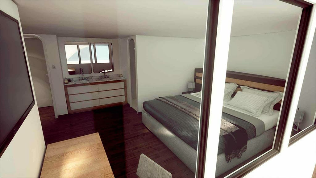 queen bed cabin with wooden flooring aboard the Tip Top 5 galapagos yacht