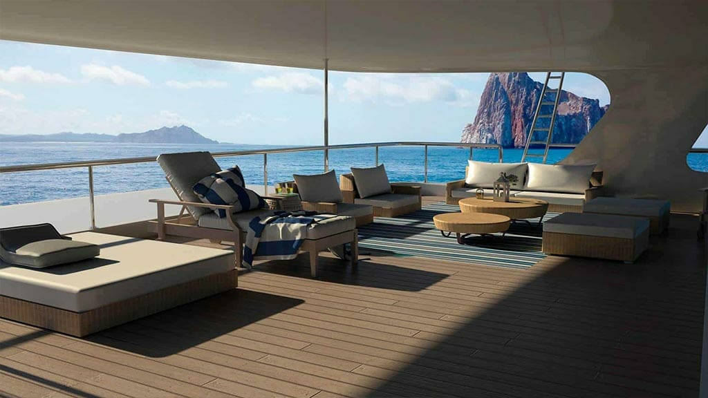 panoramic sun deck with loungers and coffee tables on the TipTop 5 yacht with galapagos views