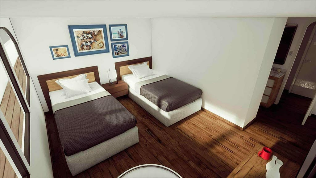 twin cabin with wooden flooring aboard the Tip Top 5 galapagos yacht