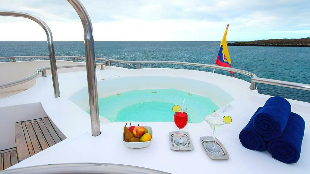 treasure of galapagos catamaran cruise - cocktails in the jacuzzi with ocean views