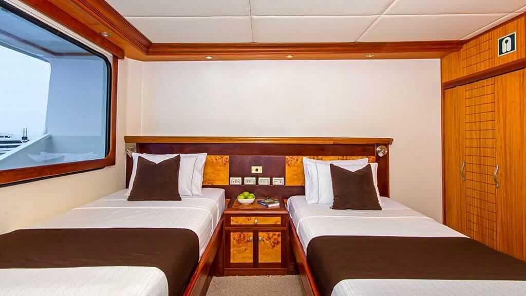 treasure of galapagos catamaran - twin bed guest cabin