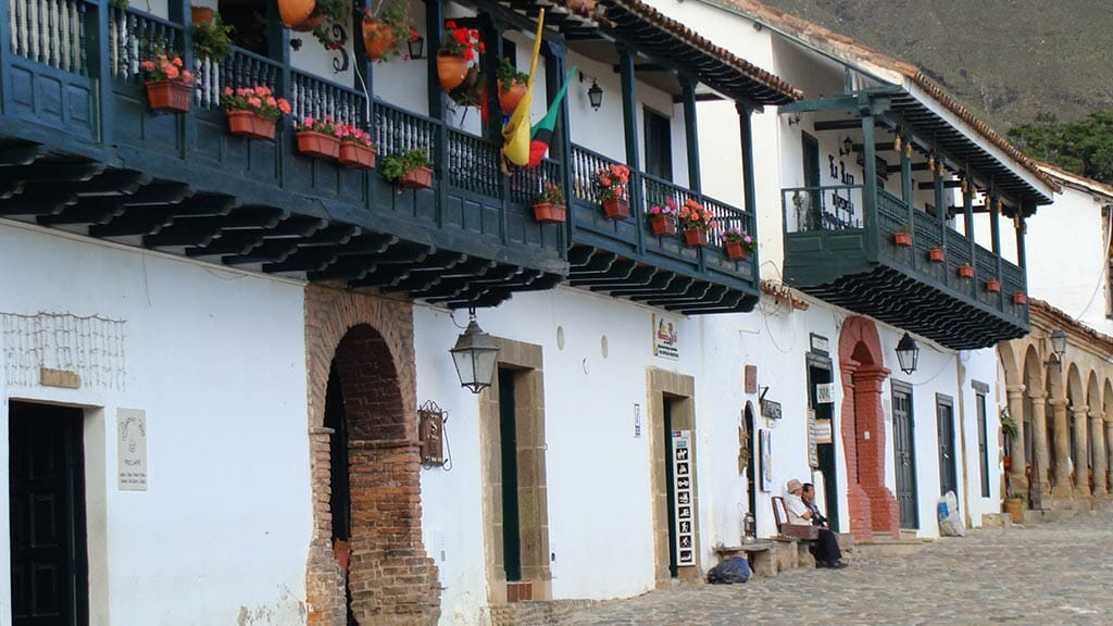colombia facade and balcony of colonial style building on cobbled street