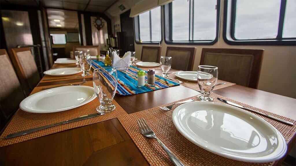 xavier galapagos yacht - dining table ready for dinner