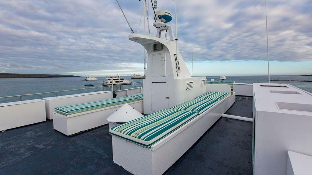 colorful seating with panoramic ocean views from the xavier galapagos yacht sun deck