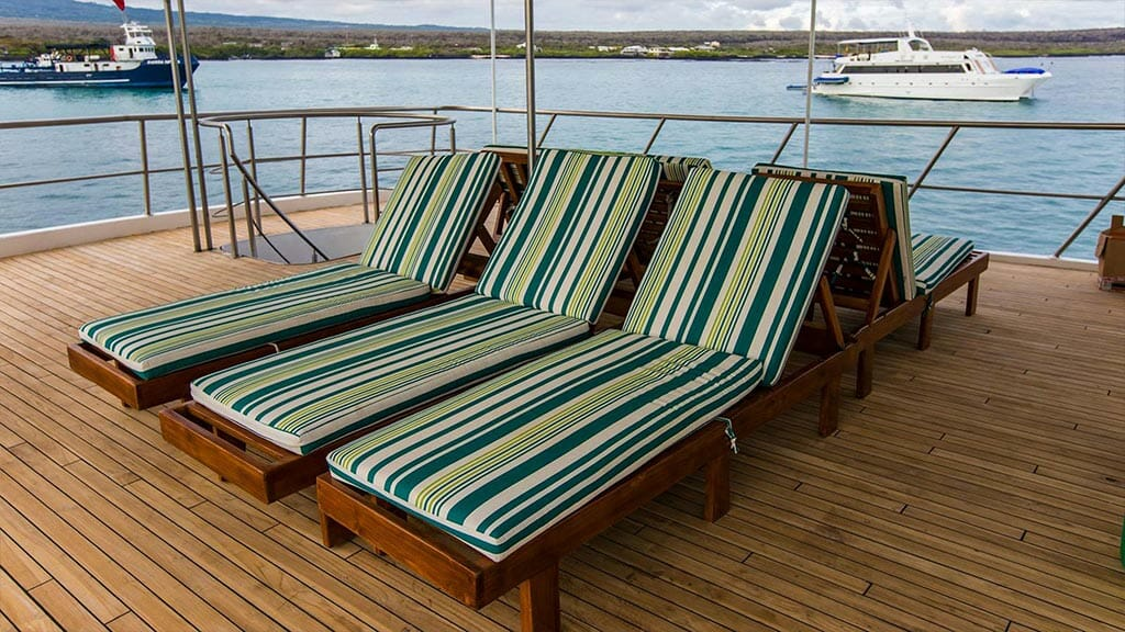 colorful sun loungers on the xavier galapagos yacht sun deck