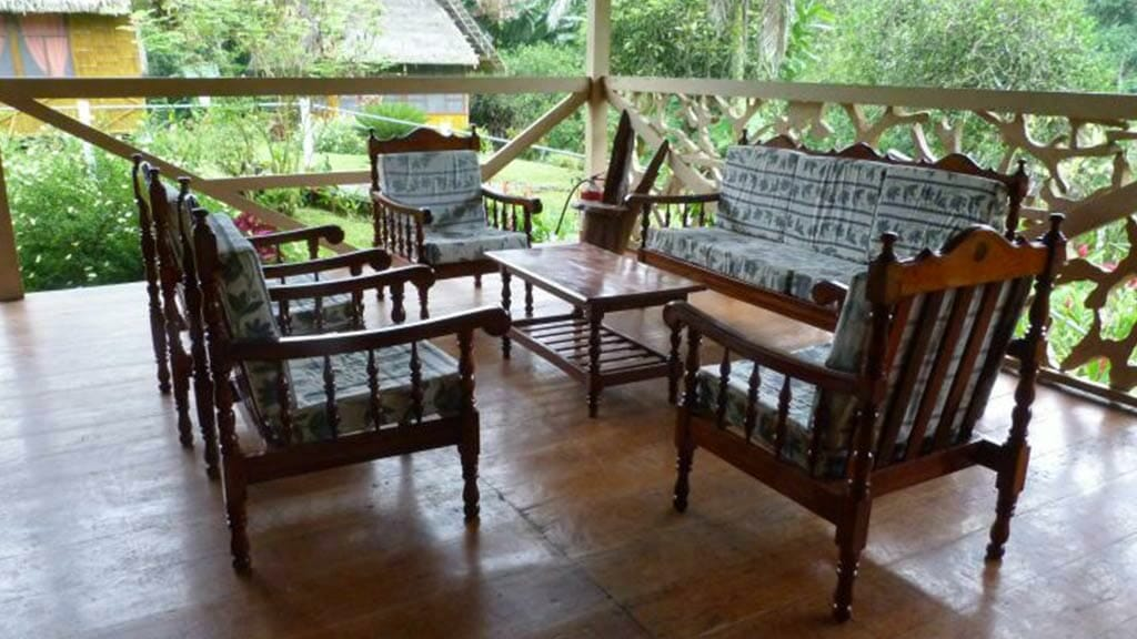 Yarina lodge ecuador balcony with sofa and coffee table