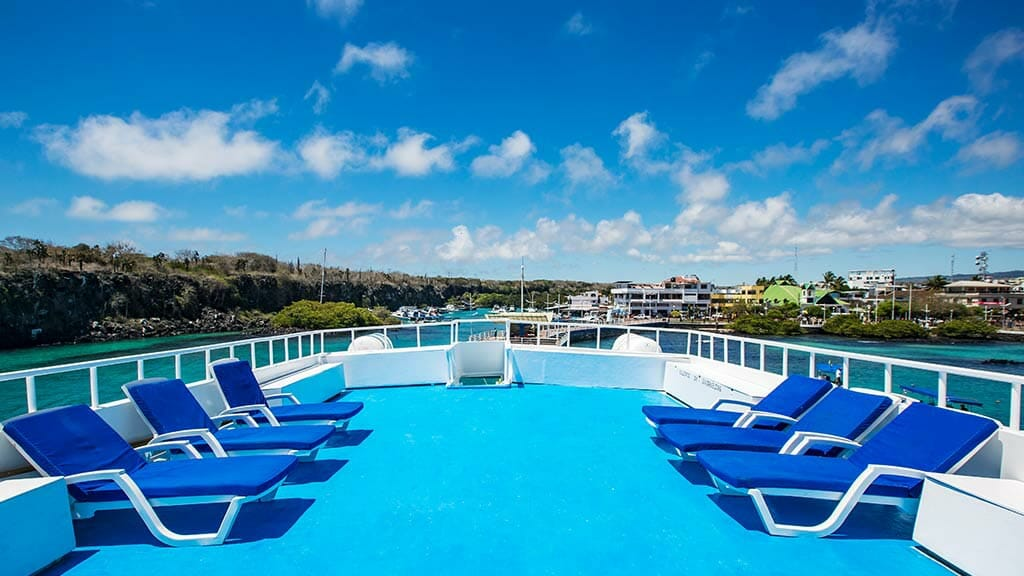 comfortable loungers and great ocean views on the Yolita II yacht sun deck