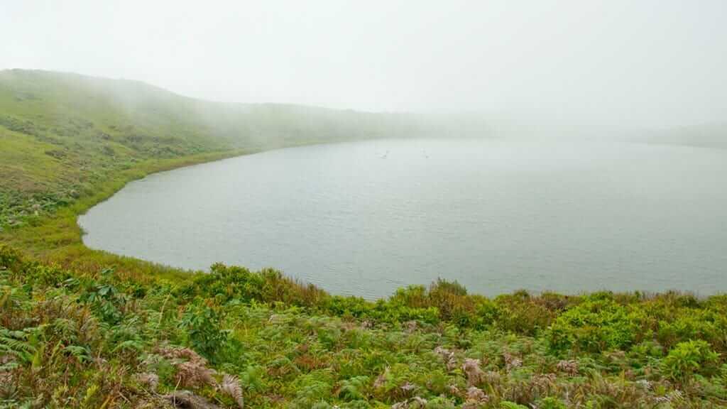 el junco lake shrouded in mist on san cristobal highlands galapagos