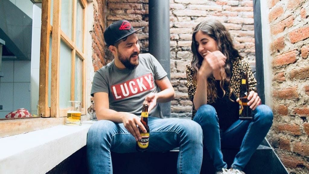 two drinkers at ecuador's indie beer company