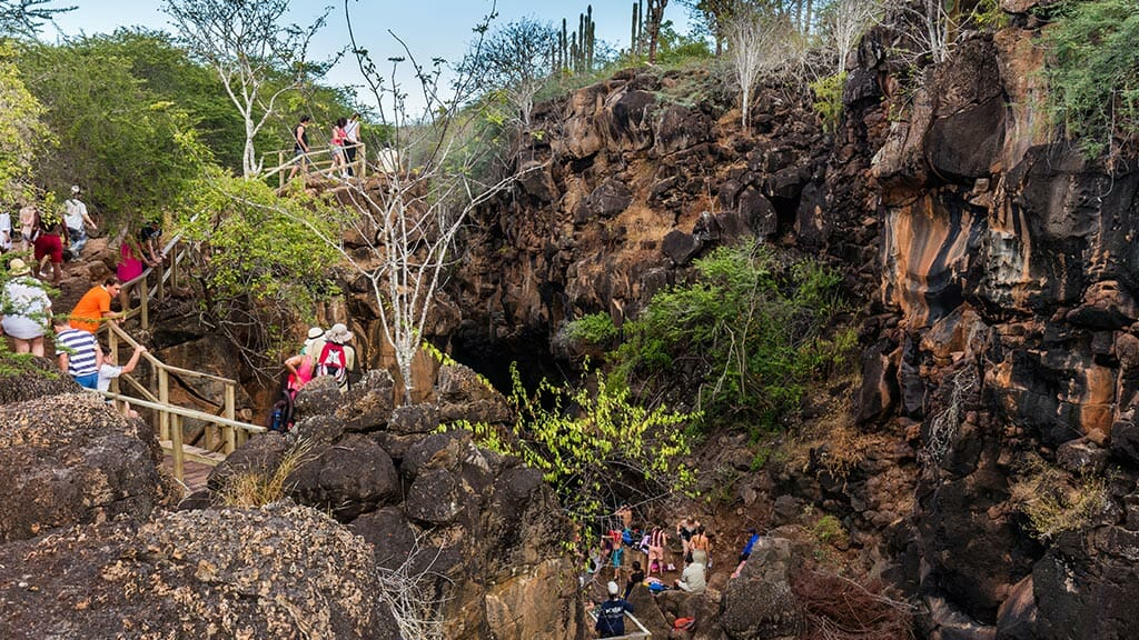 a queue of tourists at las grietas galapagos santa cruz island