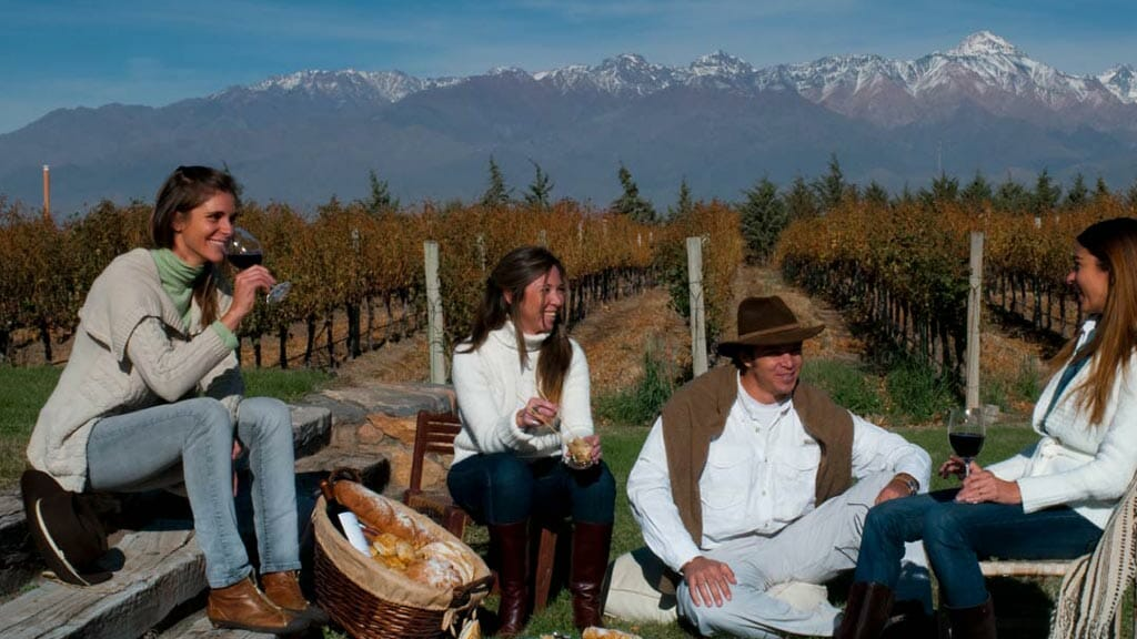 family enjoy wine tasting in a vineyard at mendoza argentina south america with snowcapped mountains