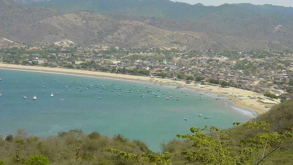 fishing boats at puerto lopez beach ecuador in manabi province