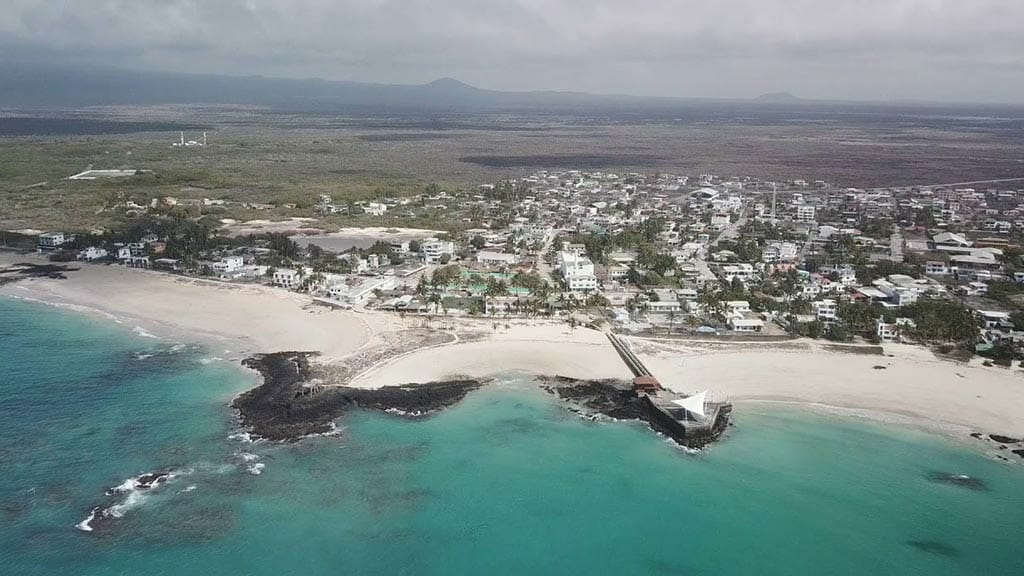 aeriel view of puerto villamil beach and town on isabela island galapagos