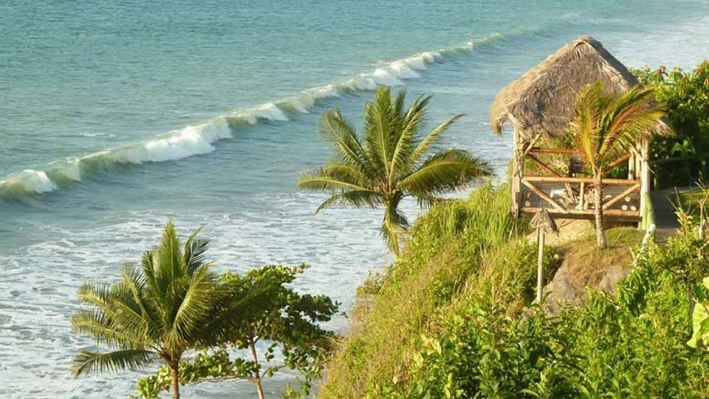 a thatched cabin lookout over same beach town in ecuador