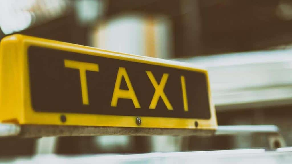 taxis sign - taxis are safe in ecuador if you follow our safety tips