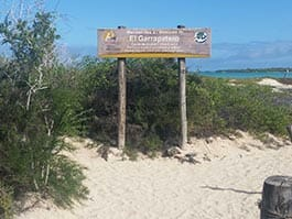 sign welcome to el garrapatero beach on santa cruz island galapagos